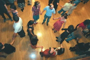 square and contra dancers at a retro dance